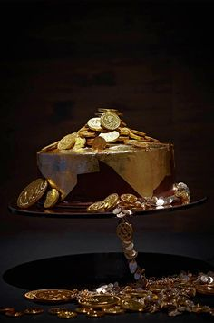 This Million Dollar Truffle cake--chocolate truffle cake with toffee and nuts and decorated with gold leaf and chocolate gold coins--is right on the money.