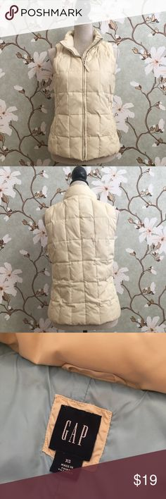 GAP Cream Colored Quilted Puffer Vest GAP cream colored quilted puffer vest. Features zip closure and two side pockets that also zip up. Priced low to reflect slight signs of wear around the armpit. In the last photo you can see where dark colored sweaters and shirts have rubbed off, leaving the material looking slightly grayish. It's not super visible, but do want buyers to be aware. GAP Jackets & Coats Puffers