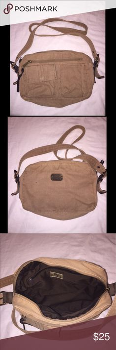 Cross body Fossil Purse Small tan cross body Fossil Purse. In good condition but has some stains, as pictured. Measurements are *approximately* - 9 1/2 inches across, 18 inch strap drop. Fossil Bags Crossbody Bags