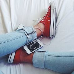Cute red converse tennis shoes with a lighter blue jean. Love
