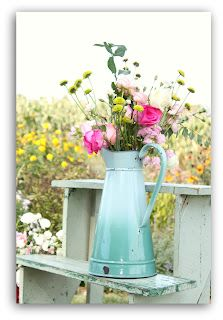 Flowers in a pitcher. This is soooooo my style!