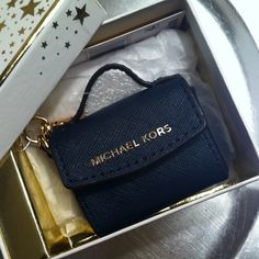 """MICHAEL KORS key charm Brand New still in the box attached to box. Miniature MK bag in Navy. Has working snap and goldtone hook with Michael Kors inscribed on it. Attach to any Michael Kors bag handle or use as a key chain. Ready to give as gift. Comes attached to original box. Approx size of mini purse is 2""""x2 1/2"""" Michael Kors Accessories Key & Card Holders"""