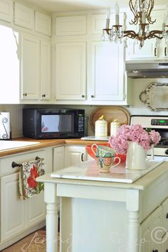 Great pops of color in a  white kitchen for summer