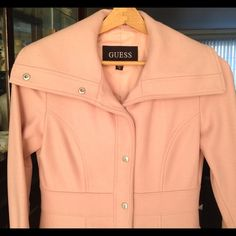 Guess baby pink coat Baby pink coat. Pink lining. Tailored fit. Two pockets. Can be worn with collar down or up for that scarf effect. Any questions please let me know. EUC. Only worn a handful of times. No longer fits. Guess Jackets & Coats