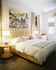 a bit too glam for me but love the simple bedding mixed with a big piece of art and patterned curtains