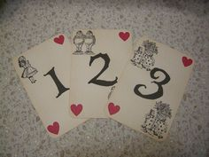 Alice in Wonderland Table Numbers - ephemera, vintage style, shabby chic style, red queen, heart, white rabbit, mad hatter, cheshire cat. $15.00, via Etsy.