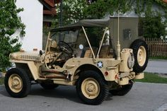 MB jeep in desert colors.