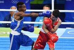 Elie Konki (FRA, blue) fights Misha Aloian (RUS, red) in a men's flyweight preliminary bout at Riocentro - Pavilion 6 during the Rio 2016 Summer Olympic Games.        -  Best images from Aug. 15 at the Rio Olympics:  2016