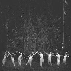 dancing women. sisterhood in a dark forest.