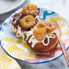 Fried Doughnuts topped with Grilled Bananas, Cream Cheese Frosting & Nutella.