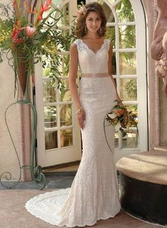 Wedding dress for skinny and petite brides features throughout lace overlay and v-neck. Slinky sheath silhouette shows perfectly curvy figure while a contrasting ribbon sash highlights at waist. Sexy back and chapel train. Colors available shown in Color Options. Custom-to-measurement for any size.