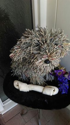 Shaggy dog made out of magazine pages. How cool is that!?!