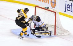 APRIL 7: Patrice Bergeron #37 of the Boston Bruins scores in a shoot out against Jhonas Enroth #1 of the Buffalo Sabres at the TD Garden on April 7, 2012 in Boston, Massachusetts. (Photo by Steve Babineau/NHLI via Getty Images)