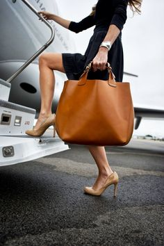 TETERBORO AIRPORT.  Zara bag. Wearing Shoshanna skirt, Elsa Peretti for Tiffany cuff. Photo by TK.