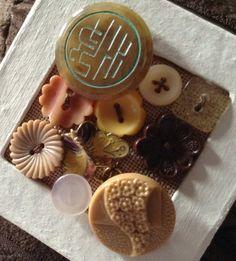 Chocolate box inspired cream square box with button design. £4.00