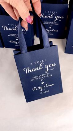 Navy blue & Silver wedding welcome bags with satin ribbon handles and your names, Elegant personalized A SWEET THANK YOU gifts and favors for guests. #welcomebox #personalizedgifts #weddingfavors #weddingwelcomebags #welcomebags #weddingfavorideas #weddingparty #weddingfavorideas #weddingparty #weddingfavour #weddingwelcome #elegantwedding #silverwedding #bluewedding #navybluewedding