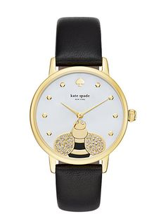 the gold-tone and mother-of-pearl dial of this kate spade new york metro watch features a crystal-accented honeybee and honeycomb-shaped indexes, set on a black leather strap.