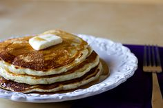 The BEST pancakes. I use plain yogurt if I don't have sour cream. Use whey for some of the milk if you have it.