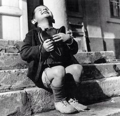 Orphan hugging a new pair of shoes by American Red Cross, 1946, Life Magazine photo