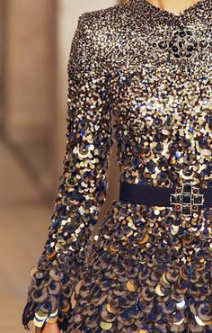 CoCo is Haute ~ Chanel 2001.  Spangled navy and gold dress.  Long sleeves, fitted bodice.  Belted - navy velvet with jeweled 'cross' buckle