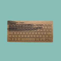 Wooden keyboard handcrafted by artisans in the south of France. (oreeartisans.com)