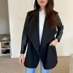 """First make of 2021 ✨Inspired by the Spanx drape front jacket and made up in wool coating and black leather knit I bought back in 2015 😱 The wool is so old it's pilling 😭 I used the #morrisblazer grainlinestudio and #burda7184 to hack this, keeping the very cool and neatly finished shawl collar of the Morris Blazer and using the """"lapel"""" and length of the Burda cardigan. Overall, this is probably one of the few things that I can wear on the daily and elevate my work from home game Drape Front Jacket, Blazer Pattern, Spanx, Wool Coat, Overalls, Black Leather, Game, Inspired, Knitting"""
