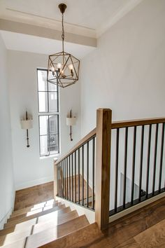 Beautiful wood staircase with chandelier and window Stair Railing Ideas beauti Beautiful chandelier Staircase stairdesign Stairs window Wood Interior Stair Railing, Wrought Iron Stair Railing, Stair Railing Design, Stair Decor, Stair Handrail, Modern Stair Railing, Stair Case Railing Ideas, Stair Risers, House Staircase