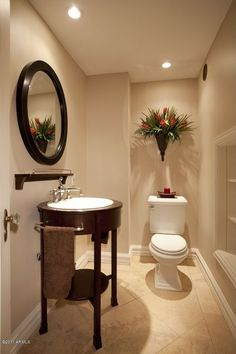 Traditional Powder Room with Yosemite home decor round decorative framed mirror, Vinyl floors, Console Sink, Powder room