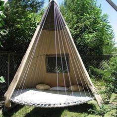 Upscaled trampoline and tent become a tranquil and modern version of tipi. From fb page: Recycled, Upcycled, Freecycled Garden Projects.