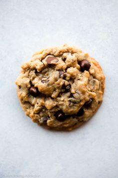 Big fat chewy peanut butter oatmeal chocolate chip cookies are easy to make and will be the thickest cookies you bake at home! Exploding with peanut butter, oats, and plenty of chocolate chips. Recipe on sallysbakingaddiction.com