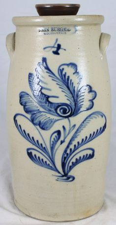 Burger, 4 Gallon Butter Churn with a cabbage flower. Sold for $3400 on 3/2011 at Waasdorp's american pottery auction.