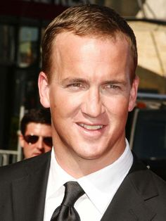 Peyton Manning  You can't tell me he isn't cute. :) <3