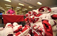 Eugenie Valentine folds each flag in preparation for packaging and distribution at Flags Unlimited in Barrie. Canadian Flags, National Symbols, News Stories, Packaging, Wrapping