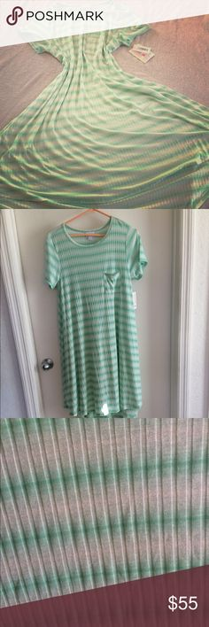 NWT lularoe carly Beautiful teal and white striped Carly. Robbed lightweight material. Super soft and stretchy. Size medium LuLaRoe Dresses High Low