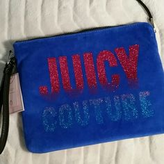 NWT Juicy Couture blue velvet clutch New with tags Juicy Couture large clutch. Beautiful bright blue color with sparkly lettering. Gold tone hardware. This is lined inside for a wet swimsuit. * willing to negotiate price through offer button *  * No trades / No paypal *  * bundle discounts * Juicy Couture Bags Clutches & Wristlets