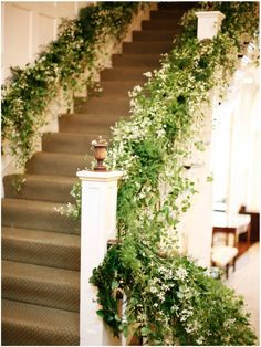 A grand staircase adorned with autumn clematis | Photo by Belathee