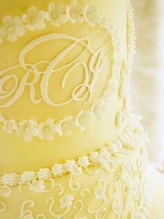 This couple added a monogram to personalize their wedding cake. See more here: http://www.bhg.com/crafts/weddings/reception/a-wedding-in-peach/?socsrc=bhgpin081112monogramweddingcake#page=22