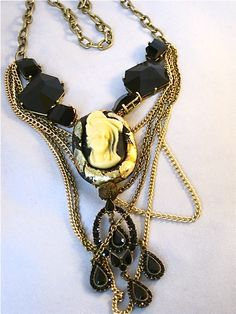 $Victorian Lush Layers. Multiple chain, cameo embedded in gold leaf, vintage elements. Big and bold