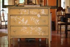 Yellow and cream painted desk with birds