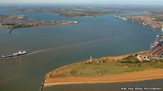 Harwich Harbour - I've just found this picture of our old house on the BBC news: we lived in the little cottage at the foot of the radar tower on Landguard peninsula. It looks so tiny in this photo! Bbc News, Golf Courses, Tower, England, Cottage, How To Plan, Places, Pictures, House