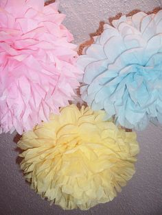 Check out this item in my Etsy shop https://www.etsy.com/listing/89260492/paper-pom-poms-set-of-12-small-poms