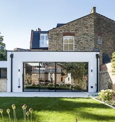 Modern rear extension, glass sliding doors, black rainwater pipe, metal capping along top of the extension's roof Sliding Glass Door, Sliding Doors, Architects London, Dutch House, Roof Extension, Residential Architect, Fulham, Open Up, Contemporary