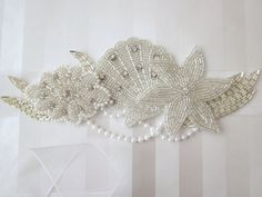 Too much going on but this is a cute idea... beachy bridal sash