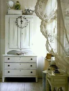 This appears to be an old cabinet with doors placed on top of an old chest of drawers painted the same color. Cool idea!