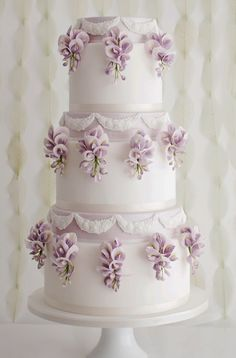 Cake Inspiration - Sugar Ruffles White ivory layered tiered cake with lavender decorations and pearl strings for a luxurious glamorous american wedding ceremonyInspiration Point Inspiration Point may refer to: Amazing Wedding Cakes, White Wedding Cakes, Elegant Wedding Cakes, Wedding Cake Designs, Elegant Cakes, Lavender Wedding Cakes, Purple Wedding, Gold Wedding, Floral Wedding