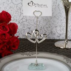 Love the symbolism of these Two Hearts Become One Silver Place Card Holders for the wedding.