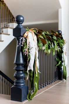 staircase garland with ribbon holiday decor | Photography: Lindsay Salazar