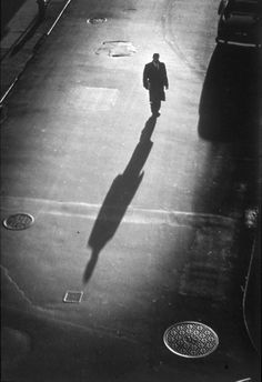 "Benn Mitchell  ""Lonely Man"", New York City. Such intrigue created through the use of the taller than life shadow and the natural dark vignette around the edges."
