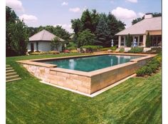 If your backyard isn't perfectly level, don't be afraid of a swimming pool - there are beautiful solutions to your problem!