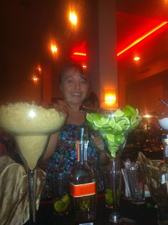 Lumi pretends to make a caipirinha herself, Wildfire Restaurant, Cairns, QLD. New Year's Eve 2011. Judging by the giant glass of brown sugar to the left, there was probably more sugar in the average caipirinha than in many desserts.